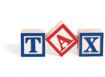 Three building blocks with letter TAX on